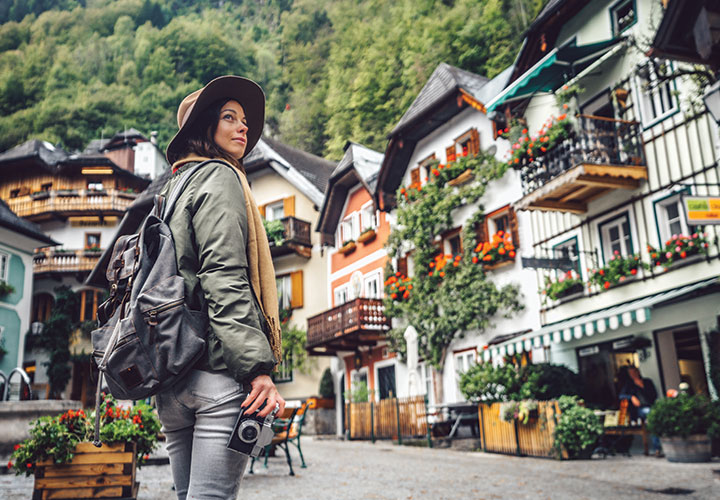 sustainable tourism shows girl backpacking in Europe